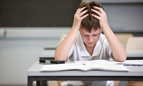 Boy struggling in exam